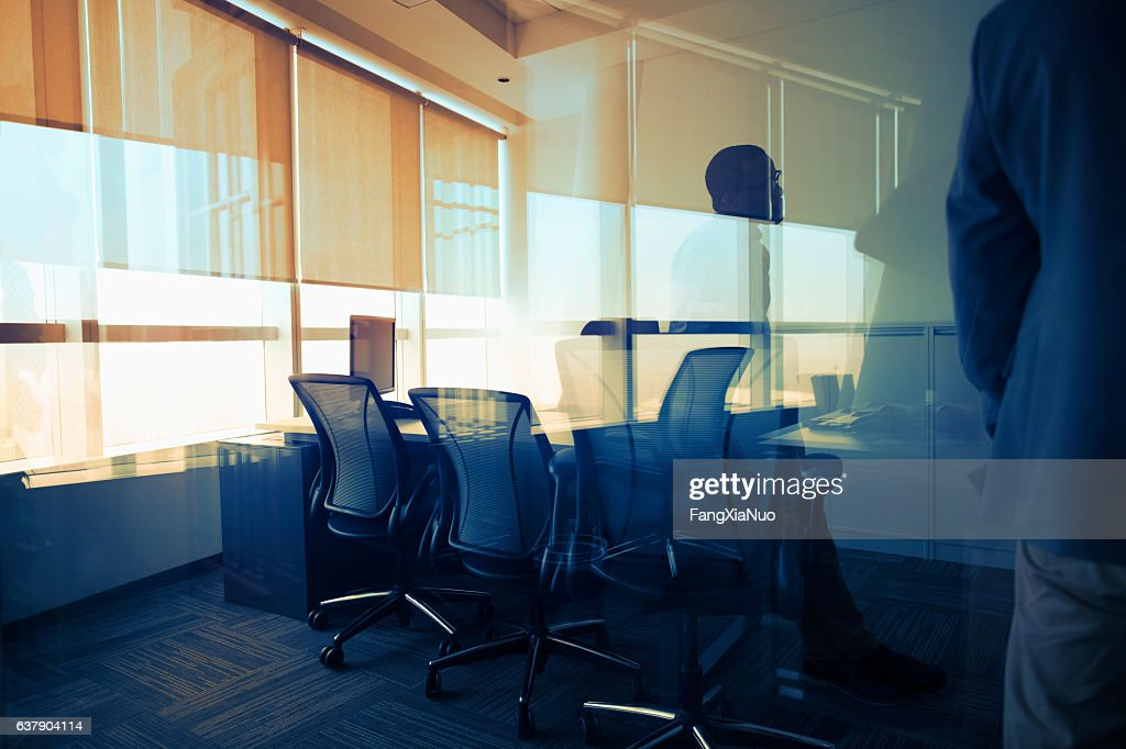 View of glass reflection in business office during meeting : Stock Photo