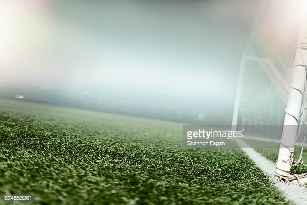 view of goal on sports field - voetbalveld stockfoto's en -beelden