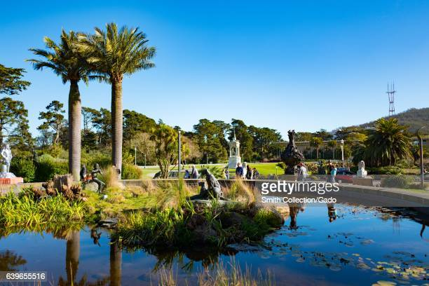 View of Golden Gate Park across a fountain with palm trees and the California Academy of Sciences visible San Francisco California January 14 2017