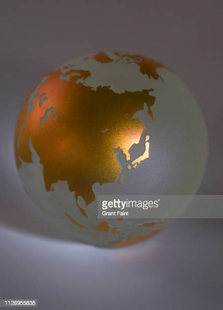 view of golden globe of earth - アジア 地図 ストックフォトと画像
