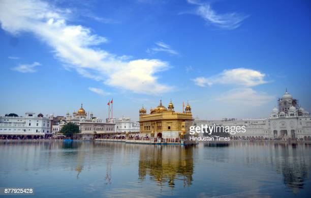 A view of Golden Temple in amid partly cloudy weather and the devotees paying obeisance to mark Martyrdom Day of Guru Tegh Bahadur at Golden Temple...