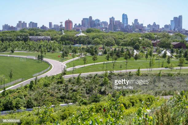 view of governors island playing fields and brooklyn - governors island stock pictures, royalty-free photos & images