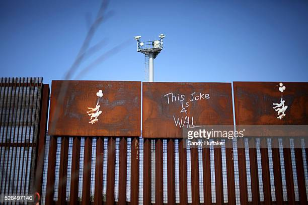 View of graffiti on the US Mexico border wall from the Las Playas area of Tijuana Mexico on Tuesday February 28 2012 Fewer immigrants are crossing th...