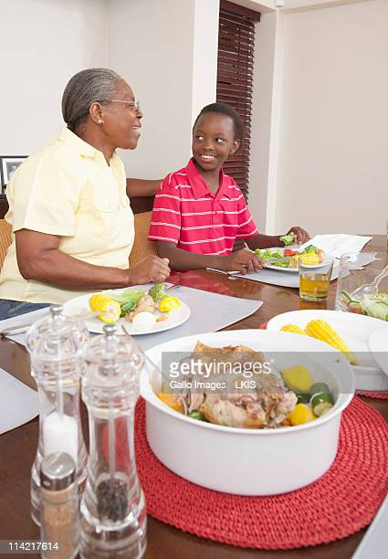 View of grandmother and granddaughter sitting at dinner table, Johannesburg, South Africa