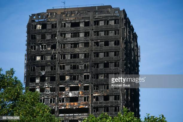 View of Grenfell Tower behind green tress June 16th 2017 London United Kingdom Grenfell Tower burned out after a catastophic fire killing more than...