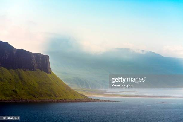 view of gribun cliffs on loch na keal, principal sea loch on atlantic coastline of the island of mull, in the inner hebrides, argyll and bute, scotland. - strathclyde stock pictures, royalty-free photos & images