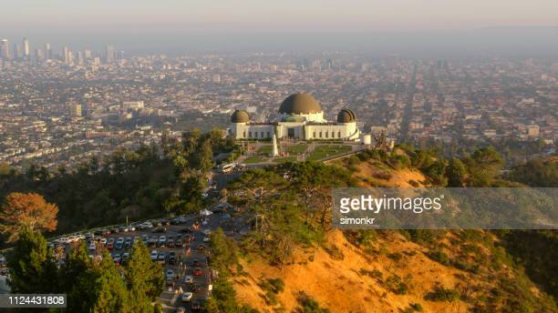 view of griffith observatory on mount lee - los angeles mountains stock pictures, royalty-free photos & images