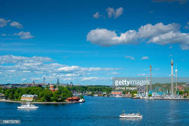 view of grona lund at sea, stockholm, sweden - lund stock photos and pictures