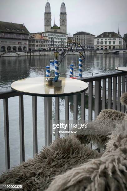 view of grossmunster church from a waterfront cafe ,zurich. - emreturanphoto stock pictures, royalty-free photos & images