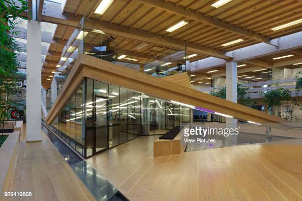 View of ground floor with windows to auditorium and reflecting pool in foreground IBC Innovation Factory Kolding Denmark Architect schmidt hammer...