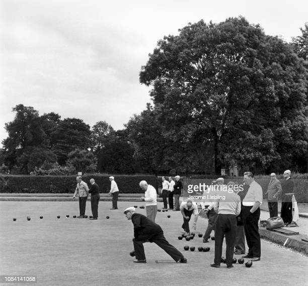 View of groups of men as they play lawn bowls in Enfield Park Enfield London England June 1967
