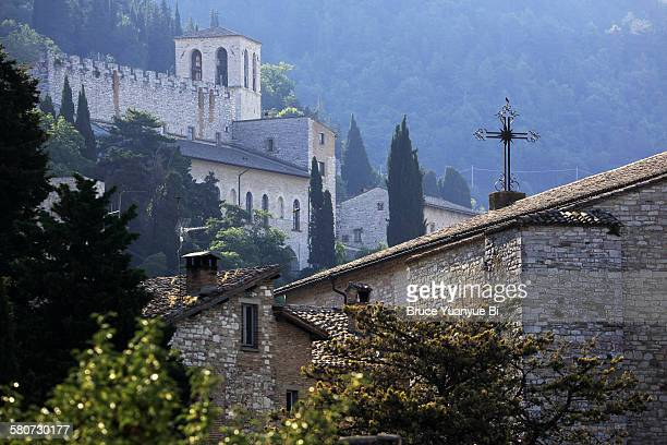 view of gubbio with tower of the cathedral in back - gubbio stock pictures, royalty-free photos & images