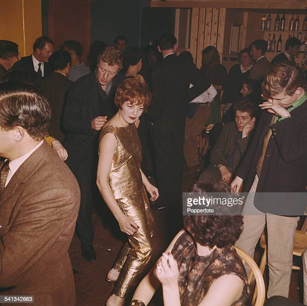 View of guests and audience members dancing the twist in the Establishment nightclub in Greek Street London in 1962 The Club which hosts satirical...