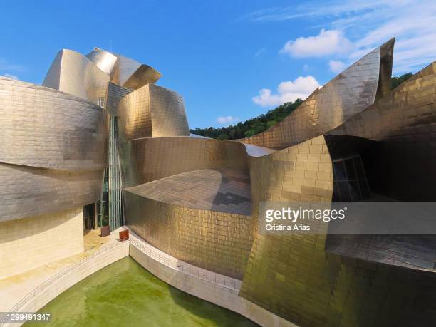 View of Guggenheim Museum designed by architect Frank O. Gehry, innovative building made up of curvilinear and twisted shapes, covered with...