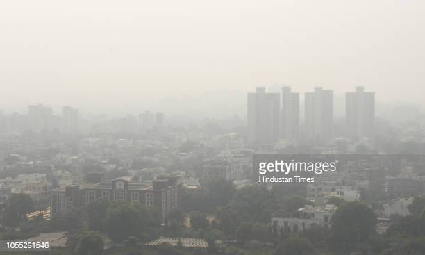 A view of Gurugram city's skyline enveloped in heavy smog and heavy air pollution on October 29 2018 in Gurugram India Air quality in the city...