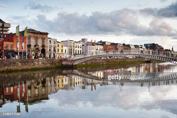 view of half penny bridge, dublin, republic of ireland - dublin republic of ireland stock pictures, royalty-free photos & images