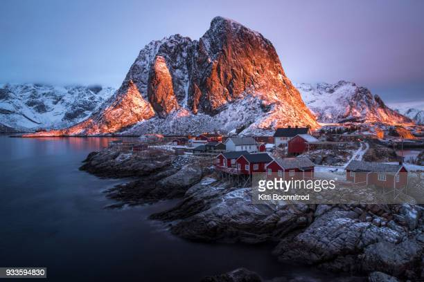 view of hamnoy village at sunrise in winter, lofoten island, norway - lofoten stock pictures, royalty-free photos & images