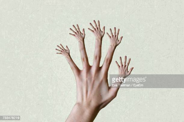 View Of Hand With Small Hands As Fingers