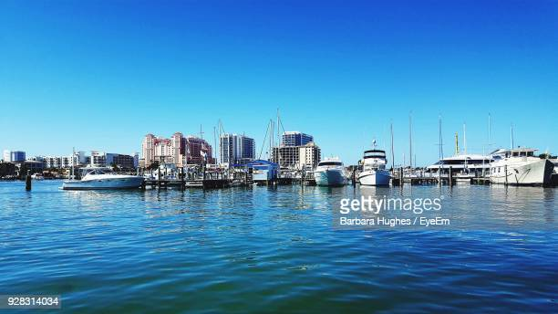 View Of Harbor Against Clear Blue Sky