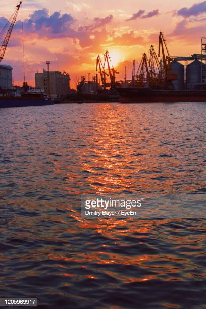 view of harbor at sunset - odessa ukraine stock pictures, royalty-free photos & images