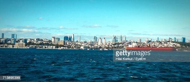 view of harbor with cityscape in background - hilal stock photos and pictures