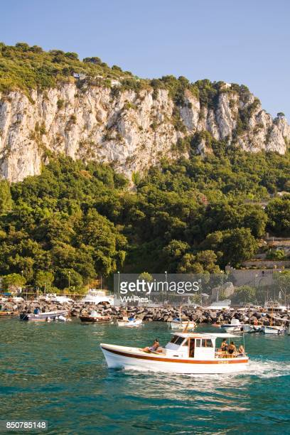View of harbour boats and mountains Marina Grande Capri Italy