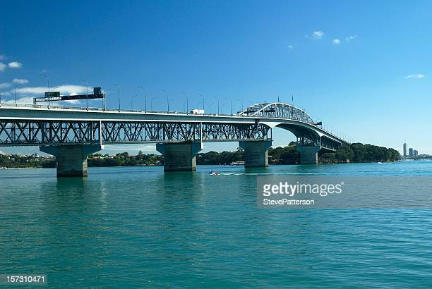 view of harbour bridge in auckland, new zealand - waitemata harbor stock photos and pictures