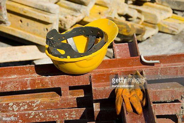 View of hard hat and gloves at construction site