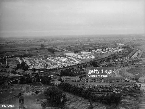 A view of Harrow Middlesex from the top of the local gasometer showing a prisoner of war camp surrounded by prefabricated homes built for bombedout...