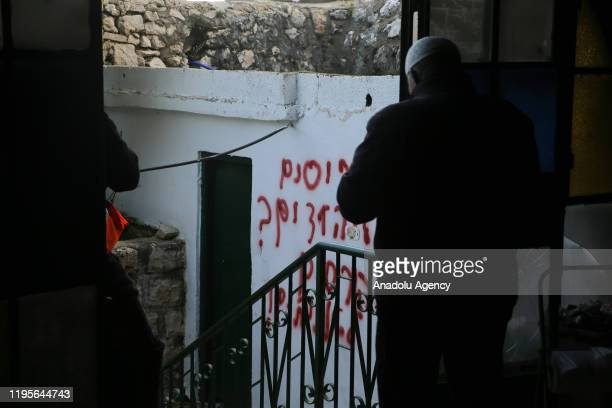 View of Hebrew racial slurs on the wall of the mosque sprayed by Jewish settlers as eyewitnesses reported that a group of settlers set fire to the...