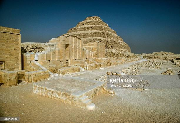 View of Hebsed courtyard with the chapels and the stepped pyramid in the background Pyramid Complex of Djoser at Saqqara Memphis Egyptian...