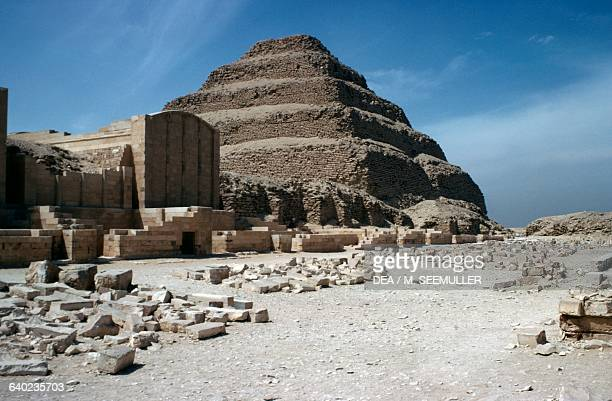 View of Hebsed courtyard with the chapels and the stepped pyramid in the background Pyramid Complex of Djoser at Saqqara Memphis Egypt Egyptian...