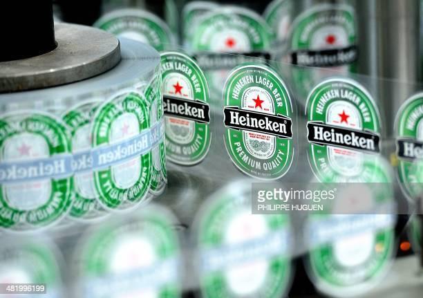 A view of Heineken beer bottle labels at the Heineken brewery in MonsenBaroeul run by the Heineken France group on April 2 2014 AFP PHOTO / PHILIPPE...
