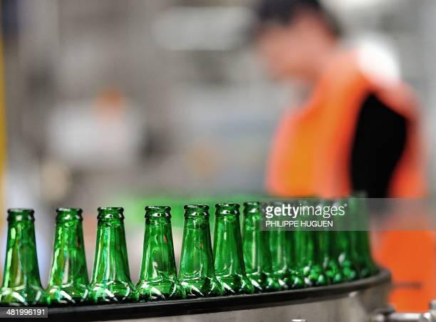 A view of Heineken beer bottles on a conveyor belt at the Heineken brewery in MonsenBaroeul run by the Heineken France group on April 2 2014 AFP...