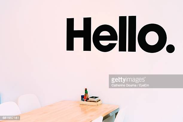 view of hello text on wall - greeting stock pictures, royalty-free photos & images