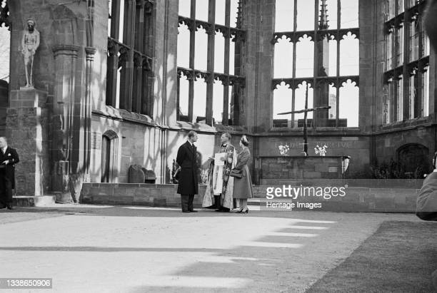 View of Her Majesty the Queen and the Duke of Edinburgh standing in the ruins of the old cathedral with Provost Howard, on the day of the foundation...