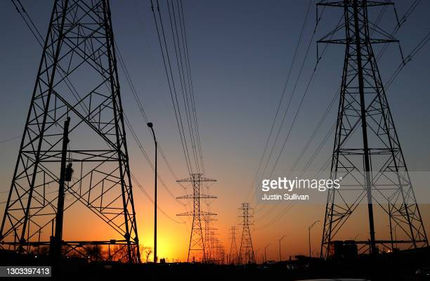 View of high voltage transmission towers on February 21, 2021 in Houston, Texas. Millions of Texans lost their power when winter storm Uri hit the...