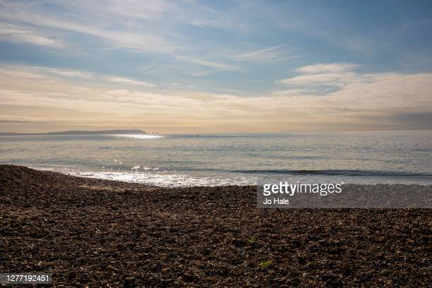 View of Highcliffe Beach and sea waves on September 28, 2020 in Dorset, England .