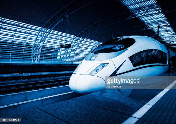 view of high-speed train arriving/leaving - 高速列車 ストックフォトと画像