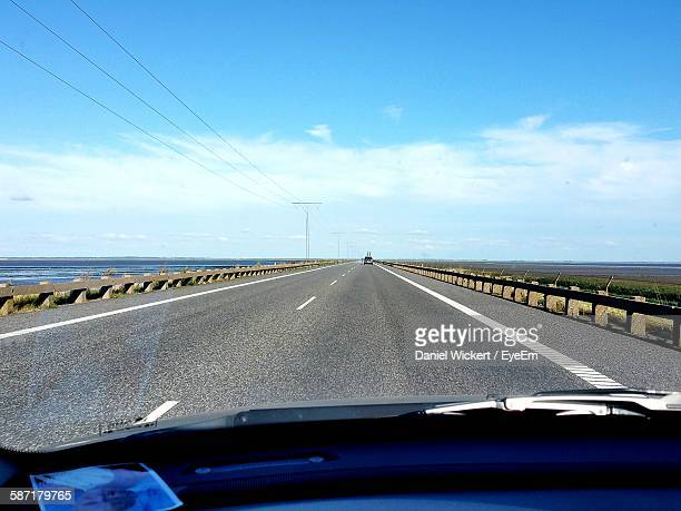 View Of Highway Against Sky Seen From Car Windshield