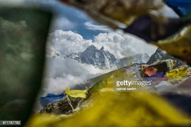 View of Himalaya mountains peak with prayer flags, Everest region, Nepal
