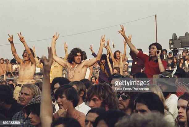 View of hippies and members of the audience shouting support for protester Yogi Joe after he invaded the stage and interrupted a performance by Joni...