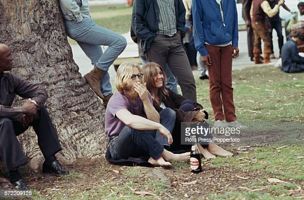 View of hippies and young people standing and sitting in a park in the HaightAshbury district of San Francisco during the 'Summer of Love' in 1967 A...