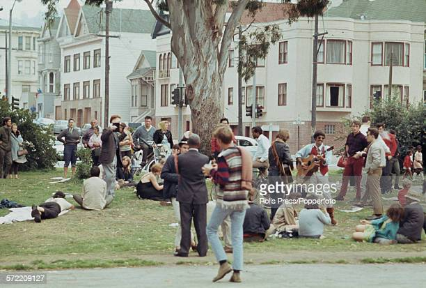 View of hippies and young people standing and sitting in a park in the HaightAshbury district of San Francisco during the 'Summer of Love' in 1967