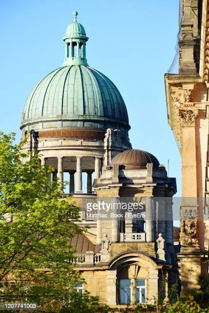 view of historic building against clear sky - kuppel stock-fotos und bilder