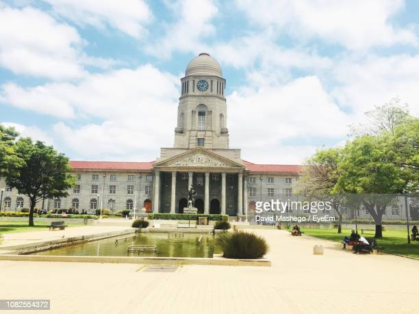 view of historic building against cloudy sky - tshwane stock pictures, royalty-free photos & images
