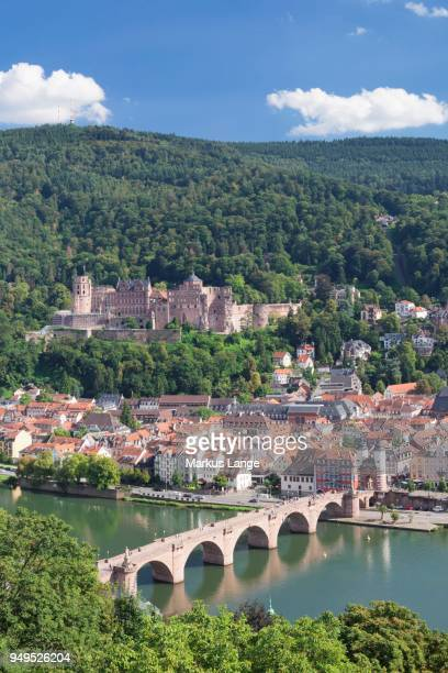 View of historic centre with Karl Theodor Bridge, gate, and castle from the Philosophers Walk in Heidelberg, Baden-Wuerttemberg, Germany