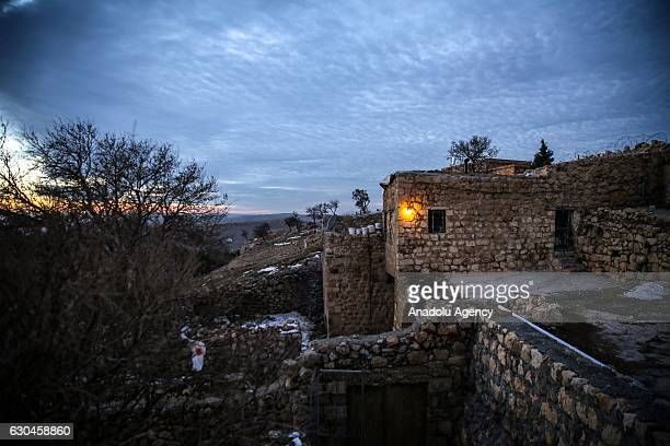 A view of historic houses seen from Kasimiye Madrasah's courtyard in Mardin Turkey on December 22 2016 Mardin hosts people from different religions...