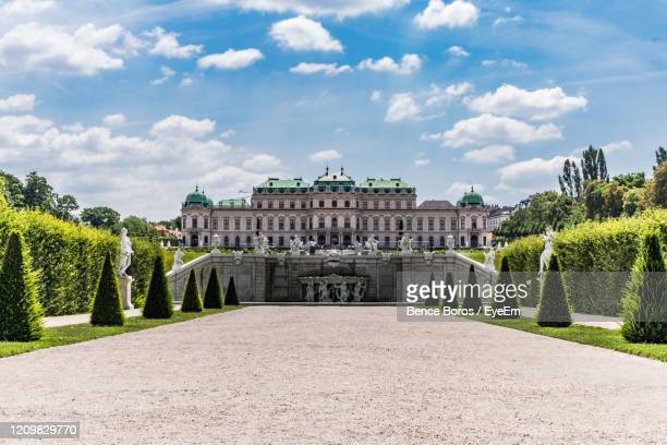 view of historical building against cloudy sky - vienna austria stock pictures, royalty-free photos & images