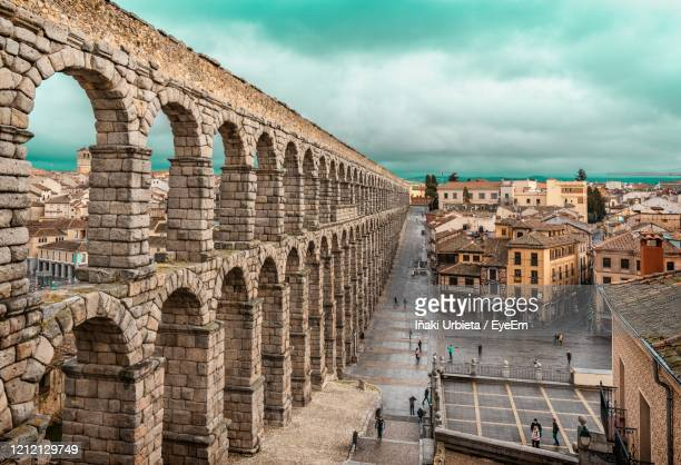 view of historical building against cloudy sky - segovia stock pictures, royalty-free photos & images